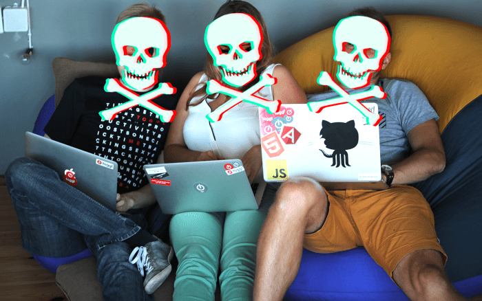 Three people on a couch working on their laptops with skulls edited over their faces
