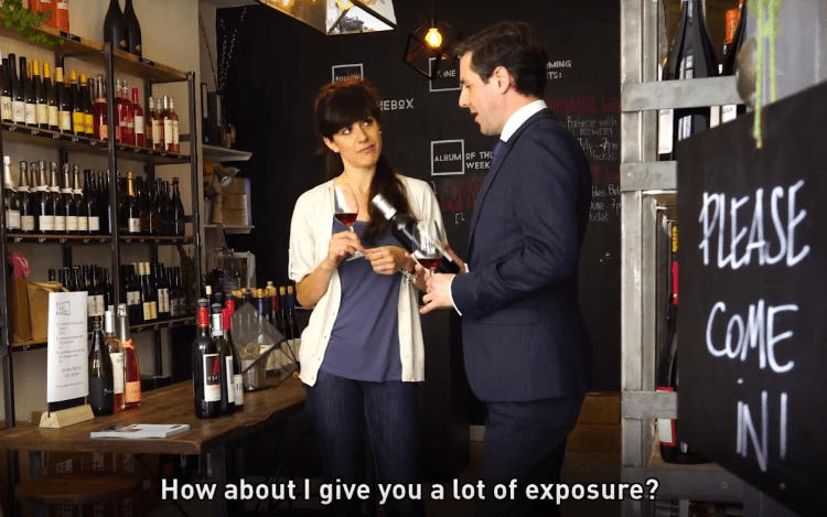 Two people talking in a wine shop