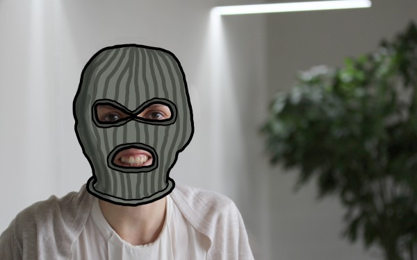 Woman with a doodled ski mask over her head