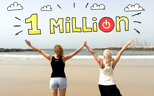 Two women at the beach celebrating '1 million Toggl users'