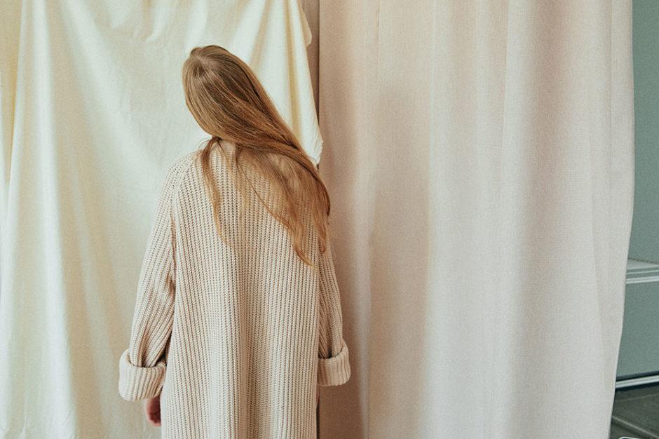 woman alone curtain
