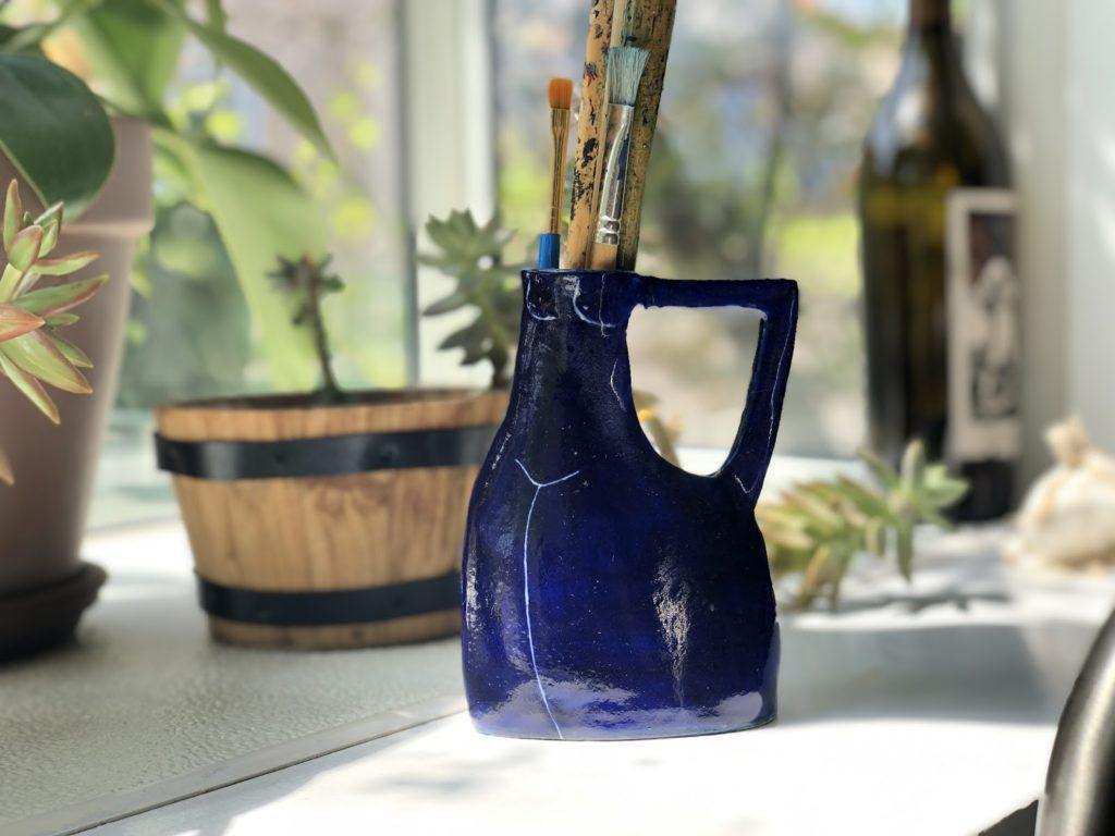 a vase that looks like a torso