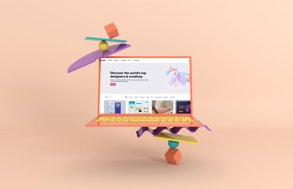 computer balancing on small 3d shapes showing a freelancer website